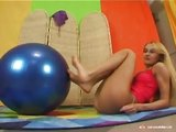 Petite blonde on a big yoga ball