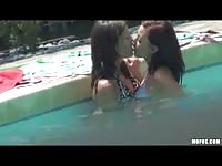 Elizabeth And Kiarra playing in the pool