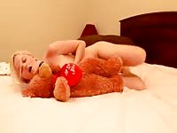 Cute teen playing with her teddy bear