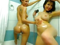 Lesbian girls having fun in the bathroom