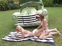 Two lesbians getting busy in the park