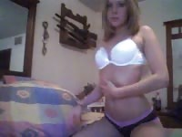 Sweet blonde stripping and touching herself in front of the webcam