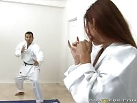 Hot busty babe losing a game of karate
