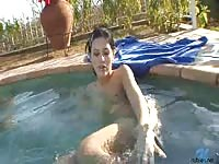 Horny teen playing with herself in the pool