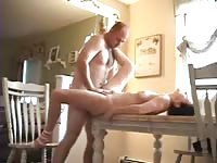 Amateur couple having sex on the table
