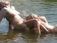 Lesbian amateurs making out in the lake