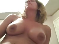 Busty amateur fingering her pussy while riding a cock