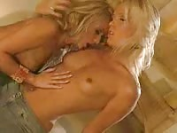 Two beautiful blondes licking each other