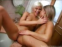 Gorgeous lesbians having sex in the bathroom