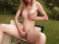 Shemale Sabrina strokes her cock outdoors