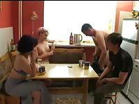Two couples playing strippoker