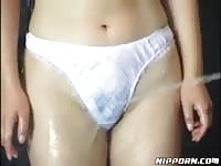 Japanese housemaid gets splattered with water