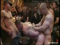 Guy gets tied up and gangfucked by a bunch of dudes