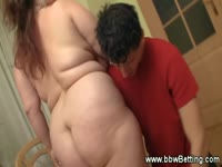 Giant boobed fat babe gets undressed by a guy