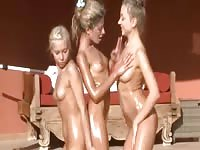Three models doing naked exercises