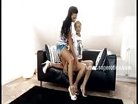 Two lesbian teens playing on the couch