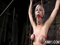 Blonde slave tied up and getting her boobs tied untill they turn blue