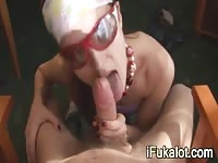 Chick giving an upclose blowjob