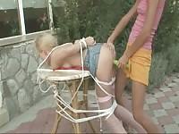 Teen girls playing bondage games in the garden