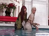 Dressed babes getting wet and naughty in the pool