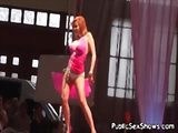 Big boobed redhead stripping for an audience