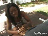 Black girl giving a hot handjob outdoors