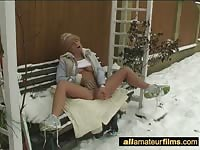 Blonde teen spreading and fingering in the snow