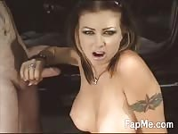 Hot girl with amazing breasts gives a handjob