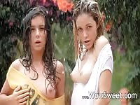 Beautiful girls undressing in the rain