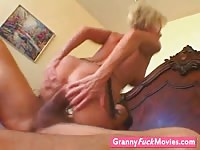 Busty mature woman riding a big hard cock