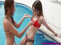 Two teen hotties having fun in the pool