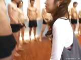 Naughty asian babe at a bukkake facial orgy