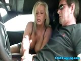 Busty amateur milf jerking cock in a car