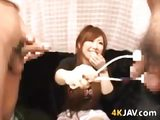 Japanese babe jerks off two cocks