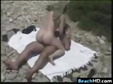 Mature amateur couple fucking on the beach