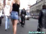 Blonde girl in miniskirt giving head
