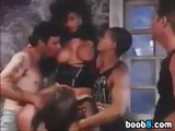Busty babe in a vintage gangbang