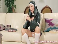 Horny gal in latex nun outfit masturbates with sex toys