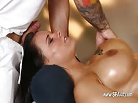 Busty brunette sucking cock in the massage room
