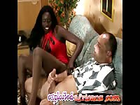 Sexy african babe gives foot job on white dude cock