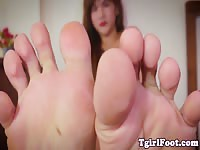 Tranny teasing with her pedicured feet upclose