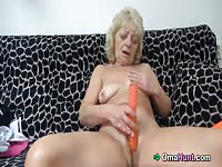 Granny inserting different objects insider her mature pussy