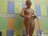 Blonde girl in the shower