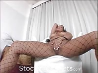 Busty pornstar Kira Eggers in fishnet pantyhose