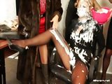 Dressed ladies getting messy with cream
